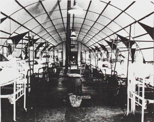 Image of the orthopaedic ward of the hospital, showing rows of beds